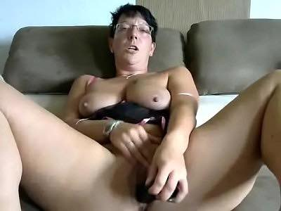 Mature Brunette In Glasses Pokes Her Twat With Black Toy